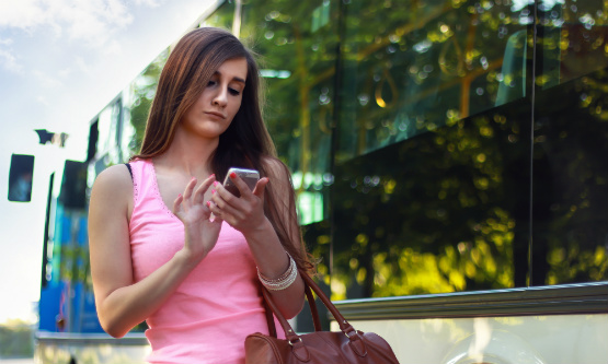 Businesswoman Checking Her Smartphone